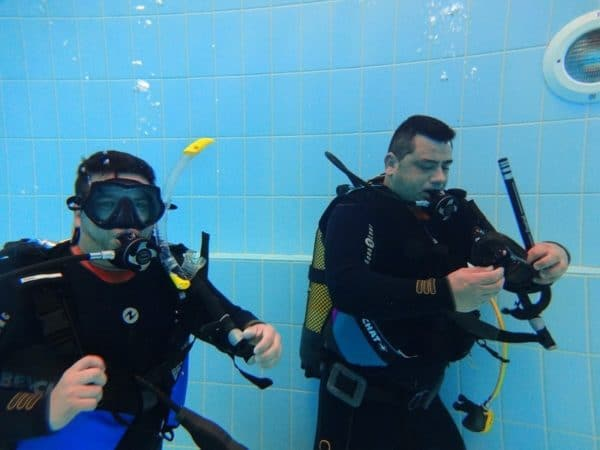 Divers practising mask clearing while training