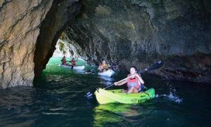 Kayaks passing through one of the Albufeira caves