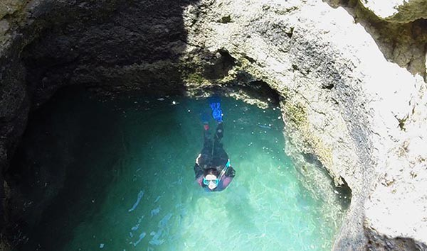 Women Snorkeling in a cave near Albufeira