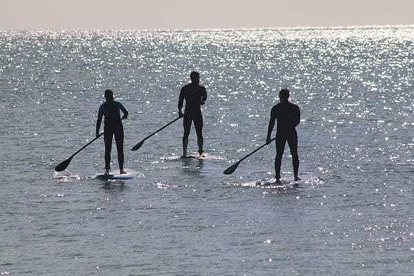 3 people on Stand Up Paddle