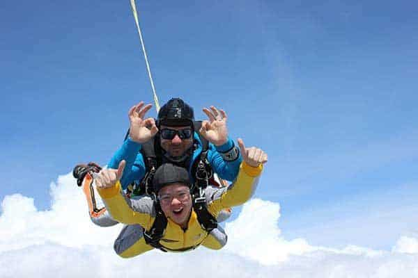 2 people having a great time in Tandem Skydive