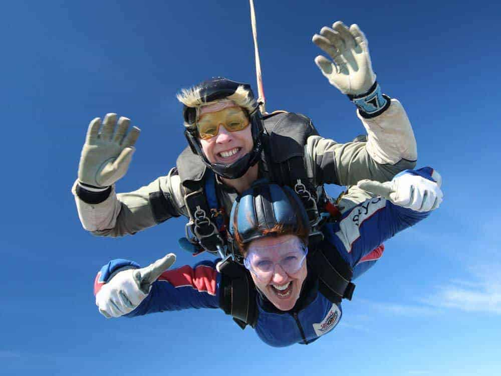 2 happy clients enjoying Tandem Skydive Experience