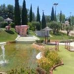Vilamoura Mini Golf with lagoon and trees in the back