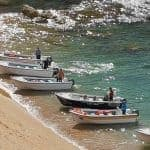 The boats for the Carvoeiro Cave Trips