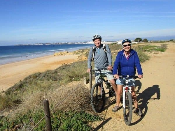 2 people on bike, near the beach, Albufeira.