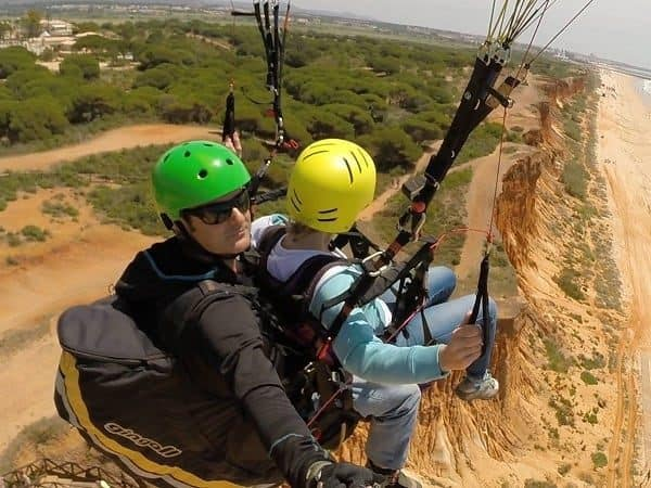 Paragliding instructor taking a selfie while on air.