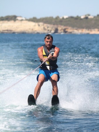 Man doing water ski, centered Armação de Pêra.