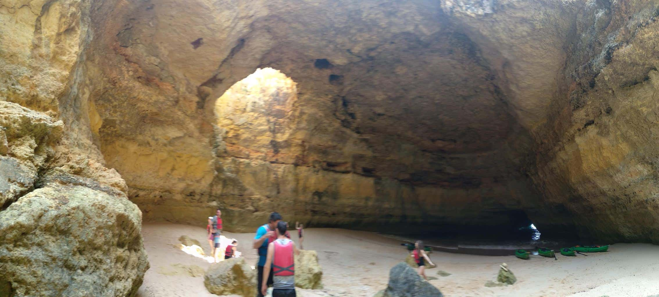 group of kayakers in a cave