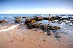 child playing in Vale de Centeanes beach