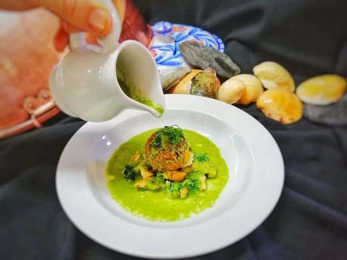 Rota Do Petisco 2 clams behind, dish with green sauce on top