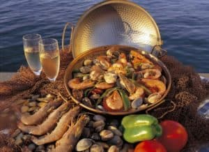 Cataplana sea food 2 champagne glasses and peppers